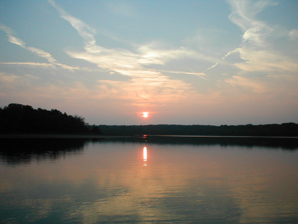 Bismarck, MO: Bismarck Lake in Missouri. Picture was taken from a boat out on the lake just before dark.