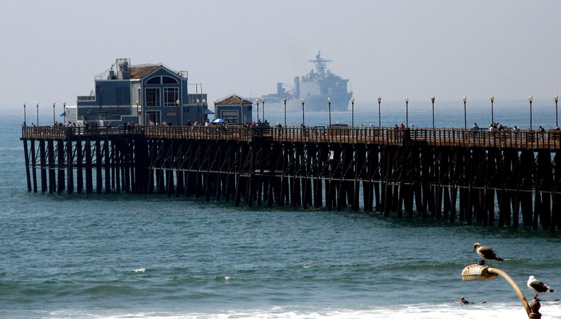 Oceanside, CA : Oceanside Pier with ghost ship approaching. A strong military presence keeping us secure at home.
