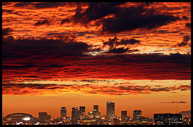Phoenix, AZ: Phoenix skyline at sunset as seen from 9 miles east