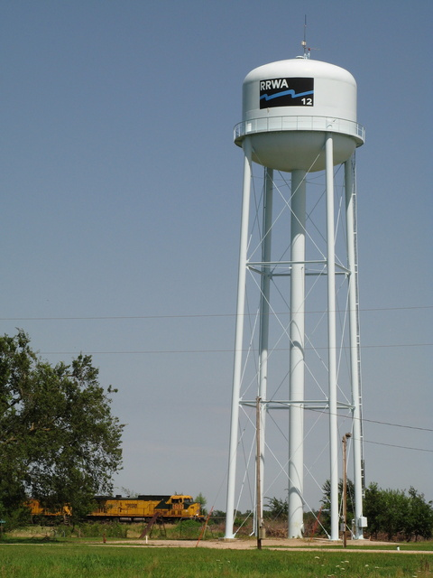 Williamson, IA: Train in front of the Williamson, IA water tower