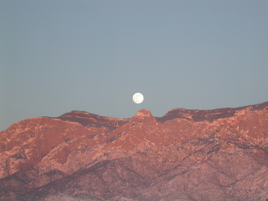 Albuquerque, NM: Moonrise and Sunset Over Sandia Mountain in Albuquerque, NM