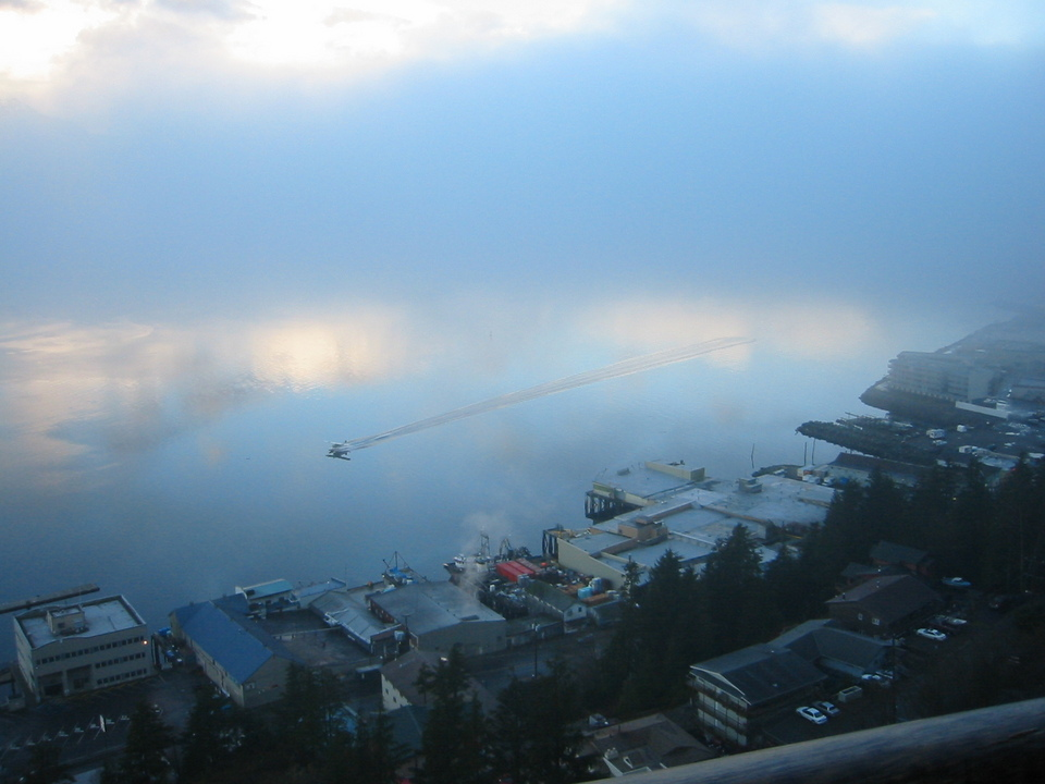 Ketchikan, AK : A floatplane taxis out of a fogbank over a mirror-like Tongass Narrows