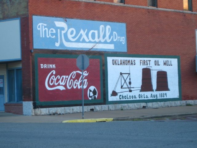 Chelsea, OK : The old Rexall Drug store this painting has been up a very long time 6 am July 18, 2010