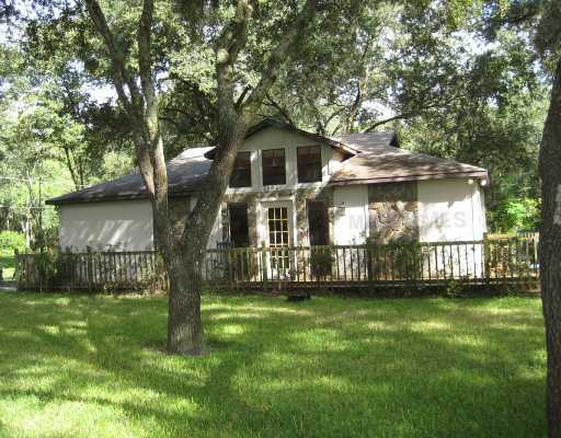 Lutz, FL: Call today..Available Feb. 1, 2011--This is not your ordinary one bedroom rental! It is a single family home and it has a fenced yard! All for $925.00 per month. (Will consider pets- conditional per owner's discretion- if accepted- a pet deposit of $200.00 is required.) Included in your rent each month is your: Cable TV, Grounds Maintenance, WIFI internet, Laundry (washer and dryer included inside of home.) Garbage, Water & Sewage. This one bedroom home has major style and has bee meticulously cared for! It is very private with trees galore! Off street parking pad. Updated kitchen appliances. The home sits on approximately 2.5 gated acres off Livingston Avenue. Country living while being less than 15 minutes from USF, North Tampa, New Tampa, and Land O Lakes/Wesley Chapel. Local schools are all A-rated as well. Home has vaulted ceilings in open great room. Kitchen has large breakfast bar with plenty of cabinet and counter space. Over sized bedroom has walk-in closet. Bathroom has full shower and tub. Neutral paint colors; updated cabinets and fixtures; tile and pergo flooring throughout. Exterior also has wrap around deck and screened + covered lanai. Must see to appreciate this tranquil retreat! Brand new energy wise A/C will also save you money on electric bills! No more than 2 occupants. Must have references and good credit required. $60.00 application fee per applicant 18 and over. Smokers must smoke outdoors on covered porch. Contact: 813-967-7165- or 813-948-3835 or email.