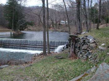 Guilford, VT : Green River Dam, built in the mid-1800s, it belonged to the Green River Paper Mill until the mill burned down in the late 1800s. It is located about 50 feet north of the covered bridge.