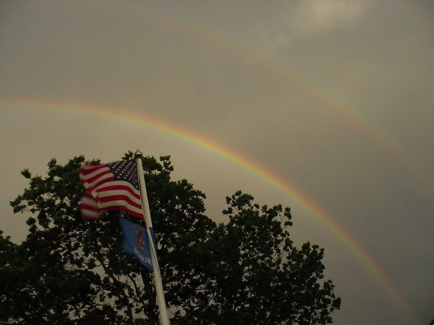 Cushing, OK : Flag with rainbow.