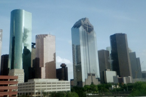Houston, TX : Houston skyline with the chevron heritage plaza in front. beautiful