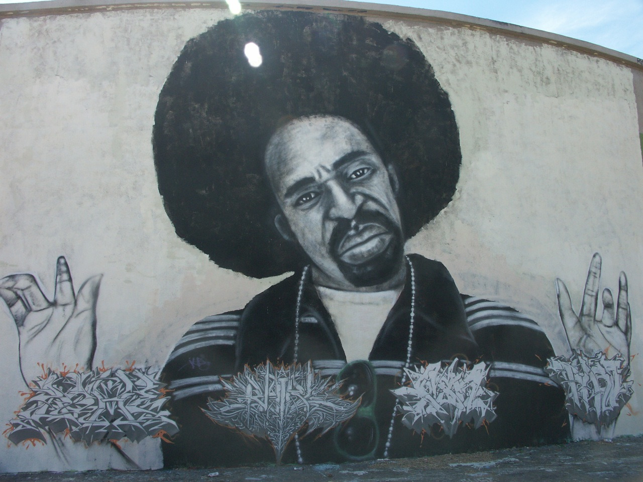 Vallejo, CA : A Mural of Bay Area legend, Mac Dre, on a Vallejo water tank