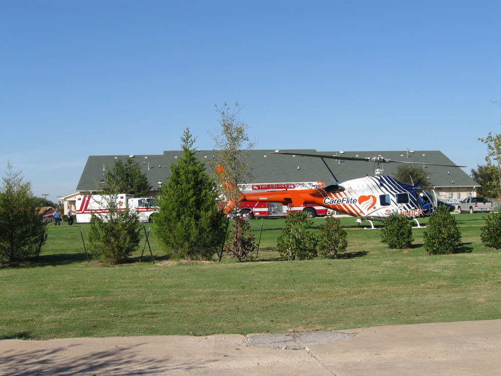 The Colony, TX : The Colony Fire Fighters working together, With Careflight